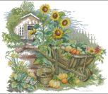 Домик в деревне с подсолнухами