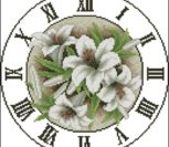 Вышиваем часы с лилиями